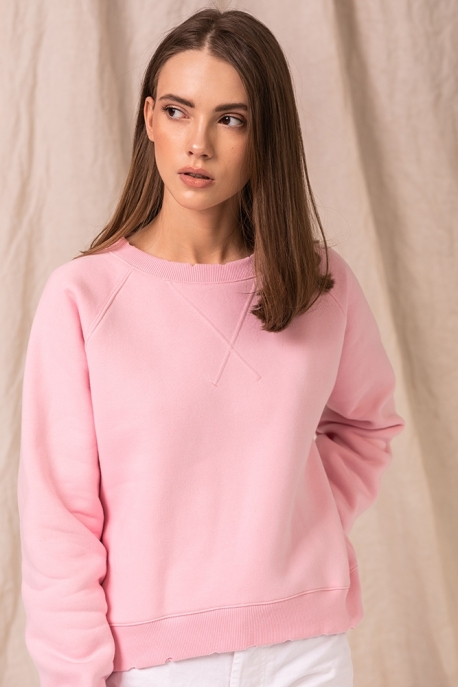 pink sweatshirt with holes