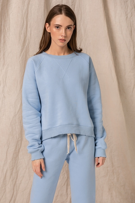 blue sweatshirt with holes