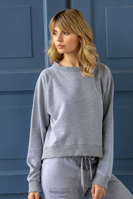grey sweatshirt with holes