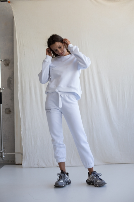 white sweatpants with text