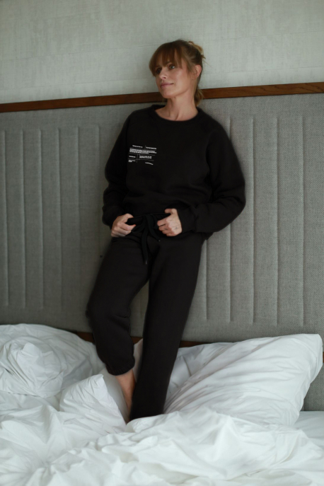black sweatpants with text