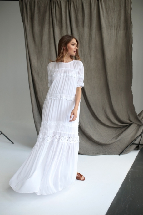 a long dress with lace tapes